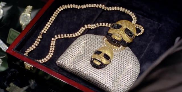 Rick ross' chain of himself wearing a chain