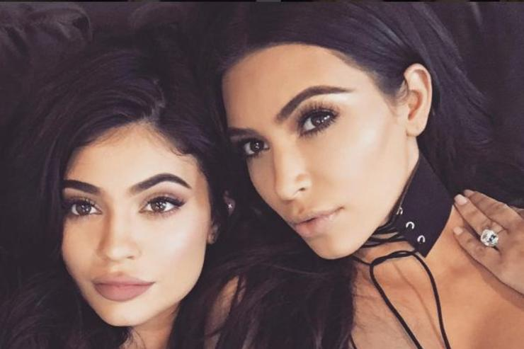 Kylie Jenner and Kim Kardashian pose for a selfie.