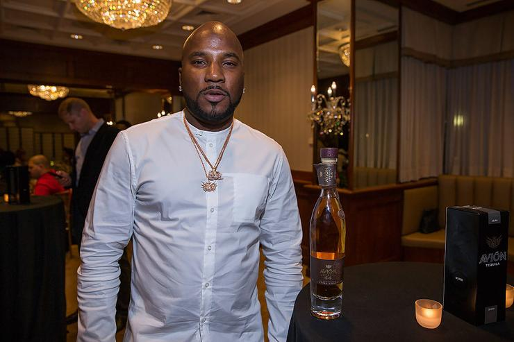 Jeezy poses with bottle of Avion Reserva 44 at the Tequila Avion Celebrates Jeezy private dinner at the Townsend Hotel on May 14, 2016 in Birmingham, Michigan.