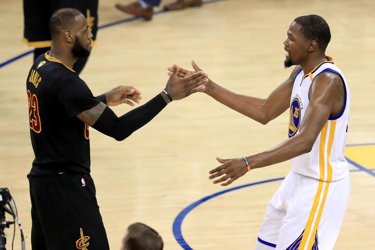 LeBron James and Kevin Durant high-five each other at the end of Game 5, NBA Finals