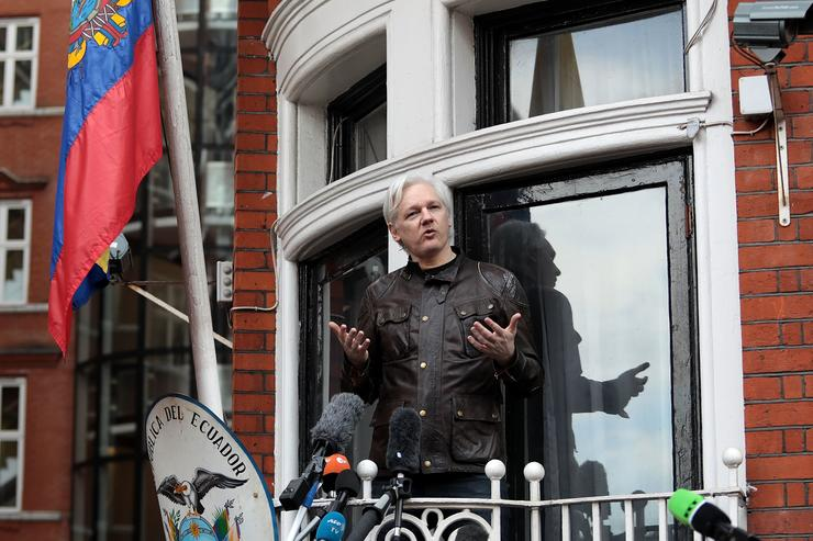 Julian Assange speaks to the media from the balcony of the Embassy Of Ecuador on May 19, 2017 in London, England. Julian Assange, founder of the Wikileaks website that published US Government secrets, has been wanted in Sweden on charges of rape since 2012. He sought asylum in the Ecuadorian Embassy in London and today police have said he will still face arrest if he leaves.