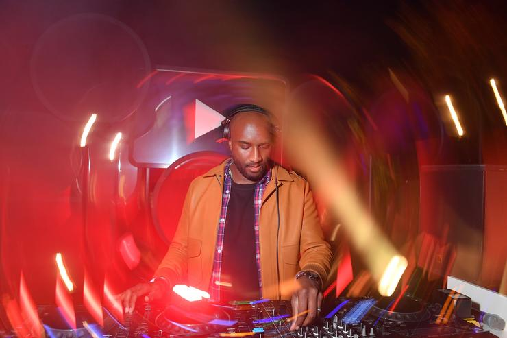 Virgil Abloh performs on stage at the YouTube cocktail party during Paris Fashion Week on September 26, 2018 in Paris, France